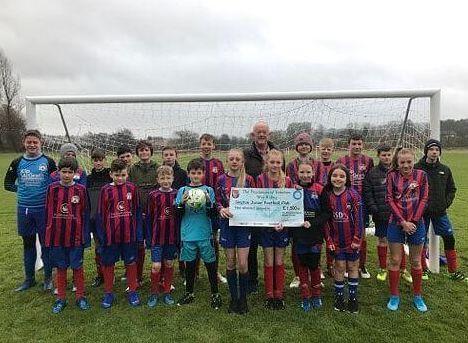 England - Freemasons help Skipton Juniors football club buy moveable goal posts
