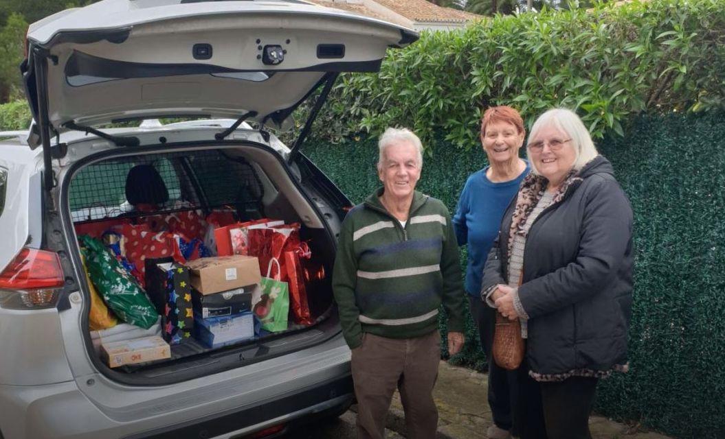 Spain - Local Freemasons help the Red Cross distribute presents to needy children.