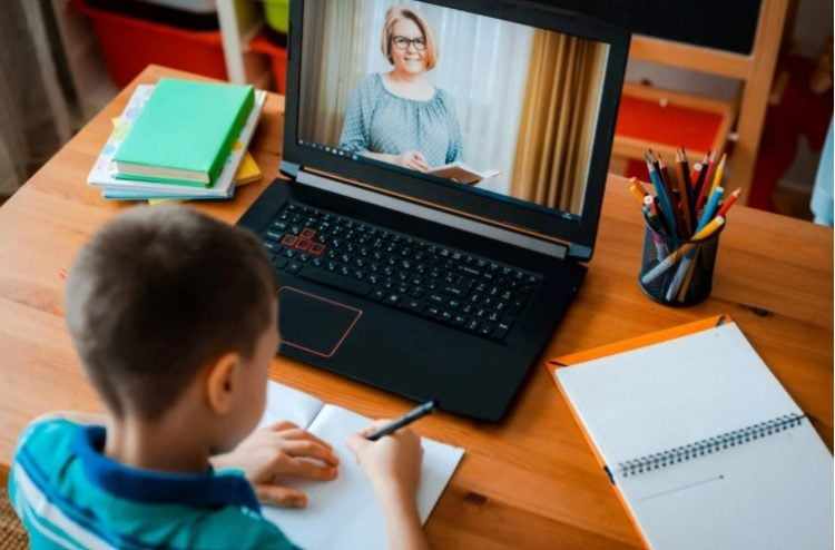England - Freemasons donate laptops to help youngsters learn at home