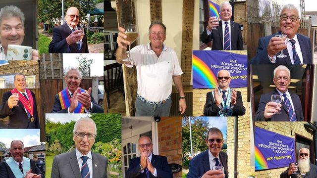 Cambridgeshire/U.K. - Flags raised, glasses raised and banners displayed for the NHS